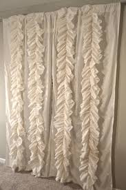 bathroom pink ruffle curtains with white chair and cream wall for