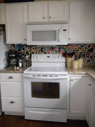 white kitchen cabinets with black island nucleus home