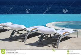 Luxury Beach Chair Two White Beach Chairs In Pool With Sea View In Greece Stock Photo