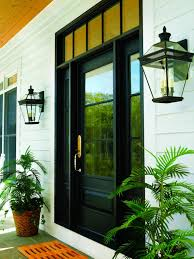 door wall lantern design with potted plant and wooden siding for
