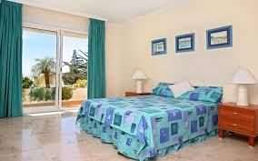 Ocean Themed Bedding Bedroom Bedroom With Beige Wall And Three Beach Photographs