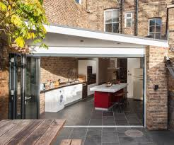 sleek kitchen modern with range hood stainless steel cooktops