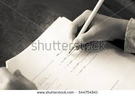 New Writing On Paper Stock Photos  Royalty Free Images  amp  Vectors     Close up kid     s hand writing on paper  writing messy math on wooden table in room