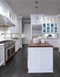 white cabinets dark wood floors wood countertop in walnut on