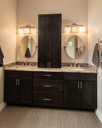this master bathroom features a double sink vanity with dark brown