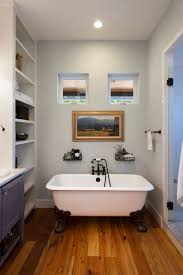 bathroom bathroom windows with claw foot tub and towel rack also bathroom windows with claw foot tub and towel rack also bathroom storage ideas for small bathrooms and bathroom vanity with wood flooring and glass shower