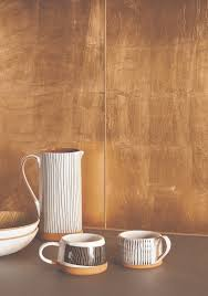 metallic copper leaf glass tiles are made by applying copper leaf