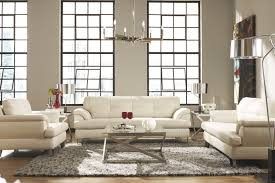 living room high barred window soft white fabric reclining sofa