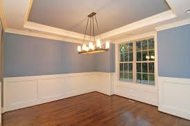 full brick raleigh homes stanton homes the formal dining room brings in a touch of blue with white wainscoting accents
