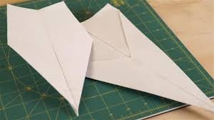 Master paper airplane designer John M  Collins holds the record for constructing the world     s farthest flying  paper  plane