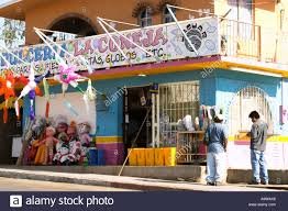 mexico cabo san lucas two men stand outside party store colorfuly