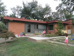 mid century modern color combination for exterior that has brick i