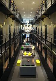 experiencing modern comfort within a former prison building hotel