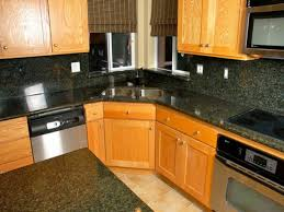 Kitchen Cabinets Wisconsin Ivory Oak Kitchen Cabinet With Black Granite Counter Tops And Back