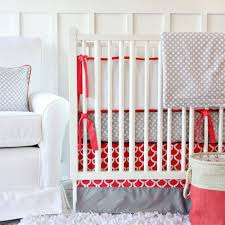 coral and gray baby bedding and nursery necessities in interior