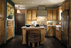 unfinished oak kitchen cabinery with small kitchen island and