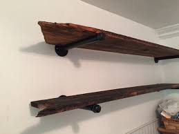 bathroom shelves made from barn wood and galvanized pipe