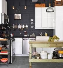small open kitchen designs with black walls and white cabinets and