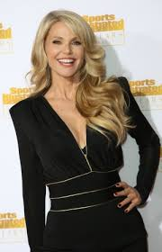 At     Christie Brinkley is happy to play the part of cougar