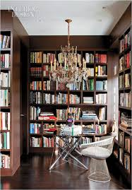 modern small home library area with white bookcase cabinets