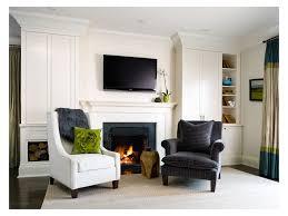 mantle built in bookshelves large white windows sofa tv above