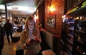 online dating cliches   and what they really mean   BBC News BBC Woman checking mobile phone