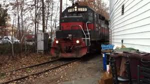 huge freight train gets inside a backyard muscle cars zone