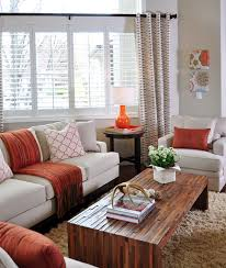 orange and taupe living room by judith balis shag rug linen sofa
