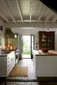herringbone wood flooring gray cabinets mable countertop and