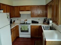 kitchens with white appliances and oak cabinets kitchen help