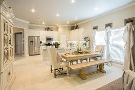 the kitchen dining area of the rebecca to see more homes visit