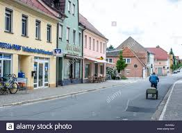 man cycling past pastel buildings in the pretty east german
