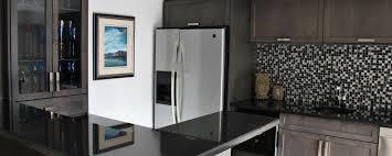 granite countertop black kitchen cabinets white appliances