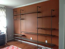 custom designed industrial style pipe shelving for entertainment