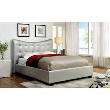 white upholstered low profile bed frame with high tufted headboard