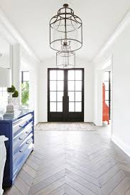 best ideas about entryway flooring pinterest beautiful entryway featuring double front doors hanging light fixtures and chevron flooring redo home