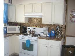 Interior White Timberlake Cabinets With Tin Backsplash And Under - White tin backsplash