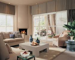 deep box pleated valances conceal the wall space above the windows