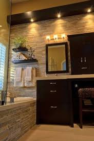 cool bathroom with natural stone bathroom tiles and dark wood