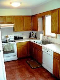 kitchen white galley kitchen with black appliances patio storage