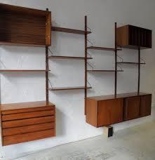 floating brown wooden shelves with black handler plus brown wooden