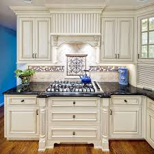 mexican tile with granite white kitchen cabinets with black