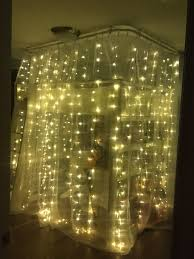 cozy magical teen bedroom fairy lights around a loft bed