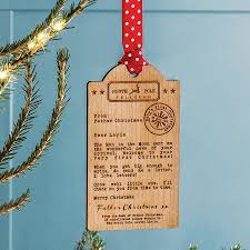 bespoke baby u0027s first christmas wooden tag decoration by betsy benn