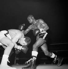 "Rubin ""Hurricane"" Carter, right, moves in on Johnny Torres in the first"