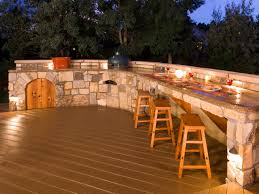 floor wood deck tiles with wood stools and stone countertop plus