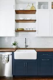dark base cabinets white top cabinets open wood shelves and big