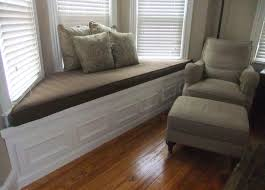 window seats with storage that will mesmerize you homesfeed amazing window seats with storage for bay windows with dark upholstery and comfy cushion together with