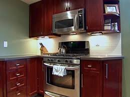 How To Paint Kitchen Cabinets Like A Pro Kitchen Cabinet Refacing With Veneer Video Hgtv