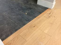 Laminate Flooring No Transitions 100 To Install This Transition Piece Between The Slate Tile And